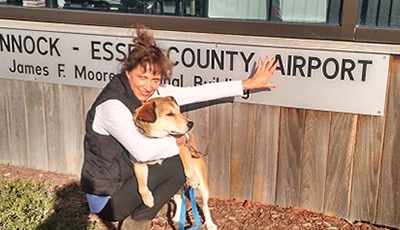 Writer Judith Reitman-Texier at Tappahannock Airport with Heather.